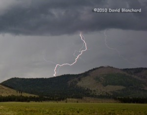 Cloud-to-ground lightning over northern Arizona showing the upward return stroke.