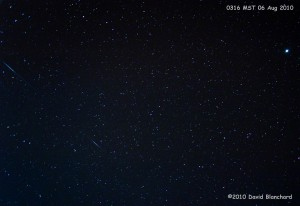 Two Perseid meteors streak across the early morning sky a few days before the peak.