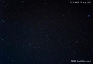 Two Perseid meteors streak across the early morning sky a few days before the peak.