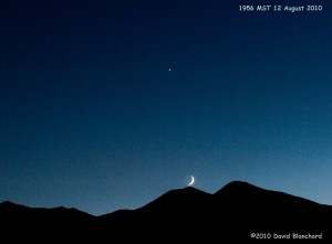 Triple planetary conjunction of Venus, Mars, and Saturn along with the crescent moon.
