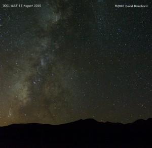 Perseid meteor streaks across the Milky Way with the San Francisco Peaks on the horizon.