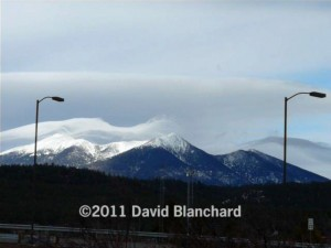 Delicate wave clouds dance across the San Francisco Peaks.