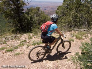 Riding along the edge of the Grand Canyon on the Rainbow Rim Trail.
