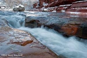 Water cascades through the sandstone, snow, and ice in Slide Rock State Park.