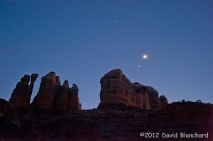 Jupiter, Venus, and the Moon shine brighly above Cathedral Rock in Sedona, Arizona.