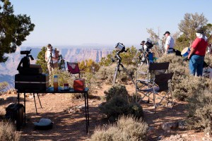 Cameras and telescopes line the edge of the South Rim of Grand Canyon awaiting the annular eclipse.
