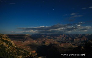 Full moon light shining down into Grand Canyon.