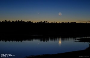 Comet PanSTARRS and the 30h-old crescent Moon -- with reflections in the lake.