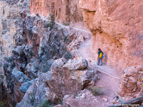 Narrow trail and steep cliffs in Roaring Springs Canyon.