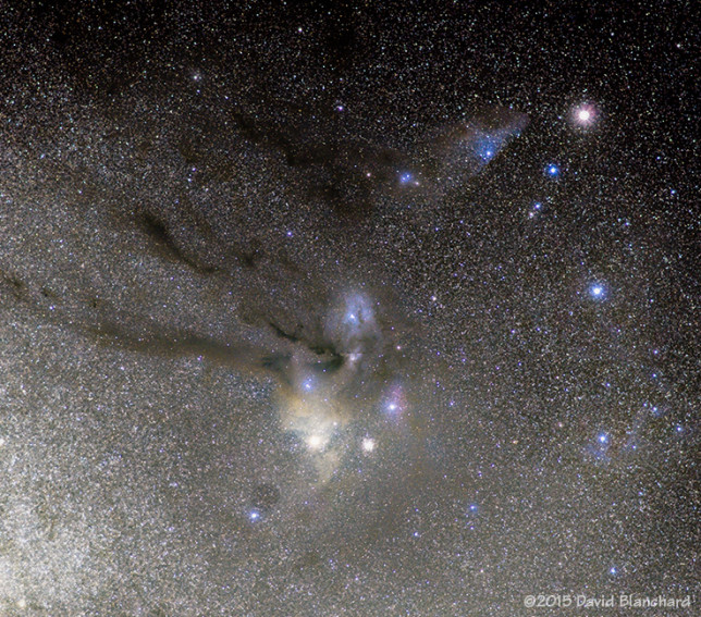 Rho Ophiuchi cloud complex. The planet Saturn is in Scorpio and is located in the upper right of the image.