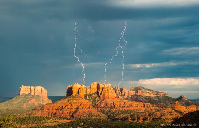 Lightning flashes behind Cathedral Rock in Sedona, Arizona.
