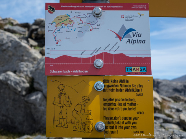 "Signs for the ""Via Alpina"" trail."