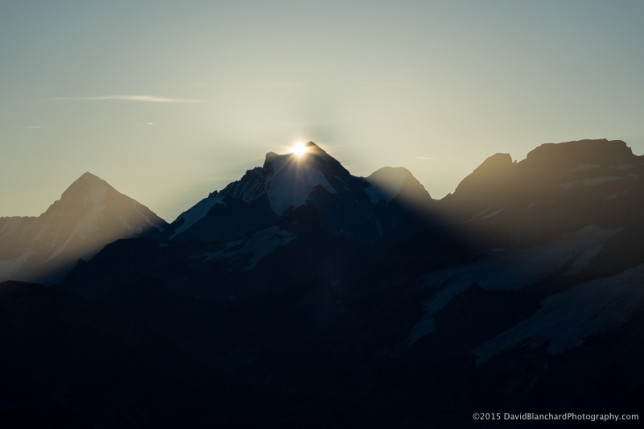 The sun finally rises above the high peaks in the east.