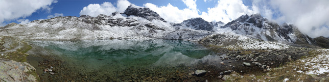 Panoramic image of Lej Muragl in the Swiss Alps.