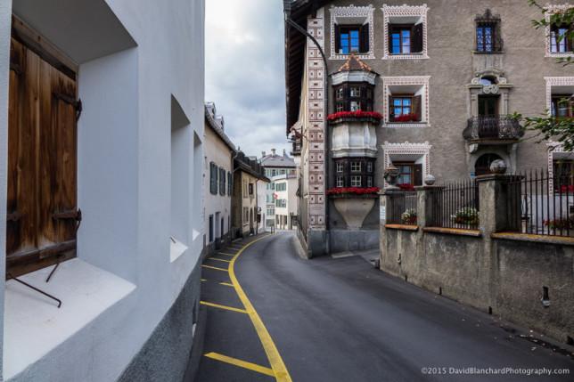 A narrow section of Via Maesta (Main Street) in Pontresina, Graubünden, Switzerland.