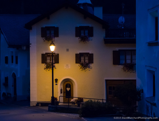 Evening lights bring a beautiful glow to the old buildings in Pontresina.