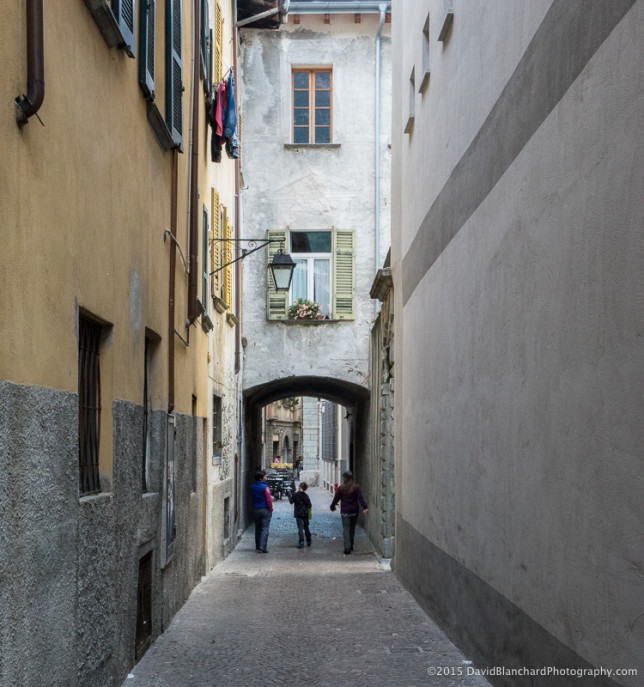 Narrow streets and bridged buildings in Chiavenna.