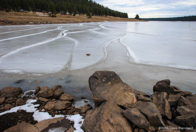 Cold temperatures and a lack of snow brings a sheet of polished—and fissured—ice to the lake