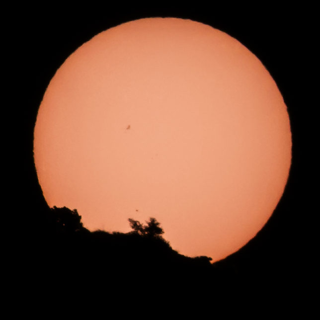 Mercury transiting the sun as it rises from behind Cathedral Rock.
