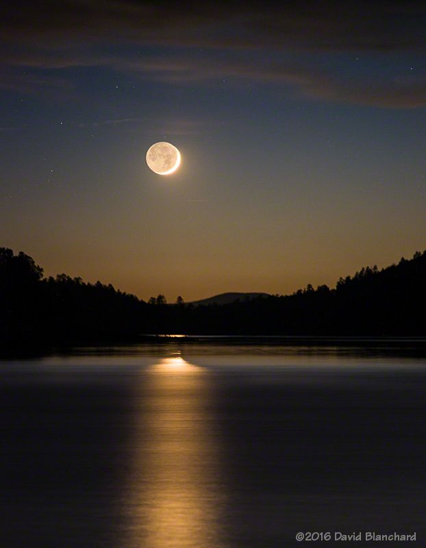 Moon with reflection on Lake Mary.