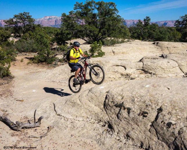 Climbing a ramp on North Rim Trail, Gooseberry Mesa.
