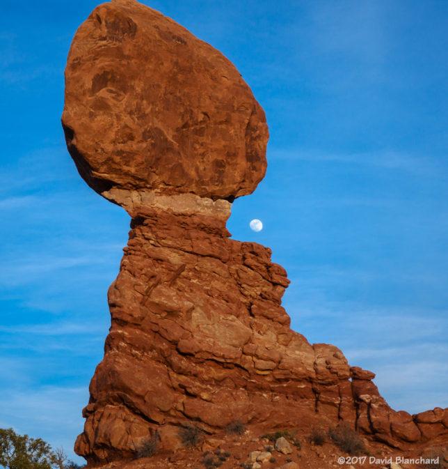 Moonrise behind Balanced Rock, Arches National Park.