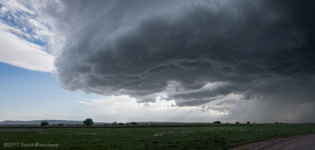 Two-image panorama of a weakly rotating storm updraft.