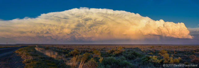 Sunset colors light up the anvil of a thunderstorm over southeastern New Mexico.