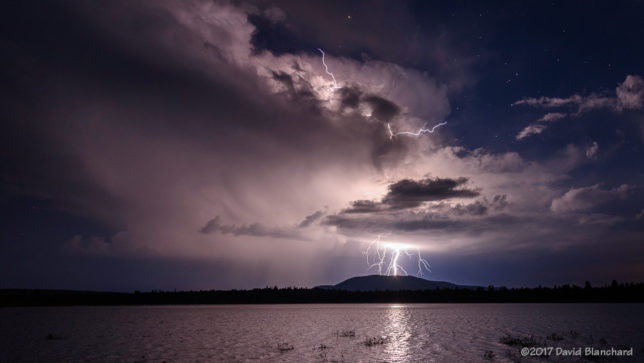 Lightning near Mormon Mt. and reflected in Lake Mary.