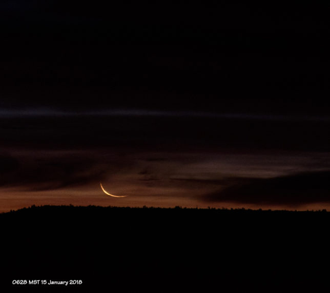 A thin crescent moon is visible for just a moment after moonrise.