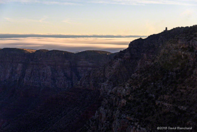A shallow fog layer lies to the east of Grand Canyon at sunrise.