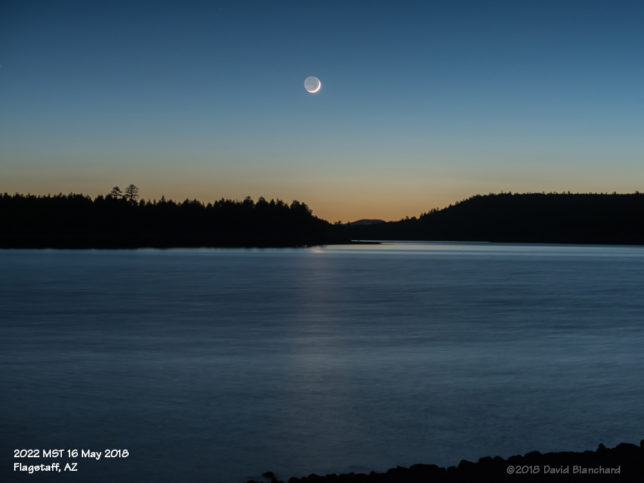 A thin crescent Moon above Lake Mary.