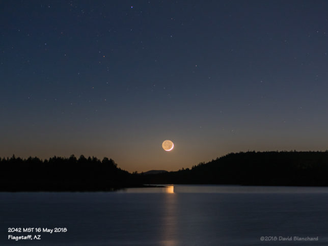 Crescent Moon with reflections on Lake Mary.