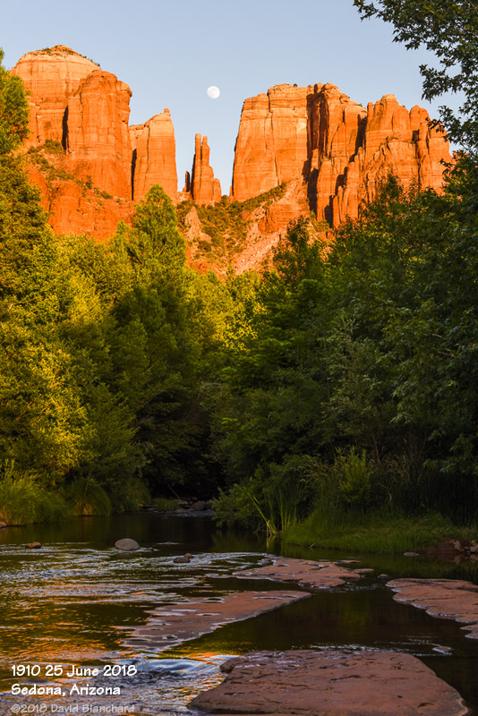 Moon rise behind Cathedral Rock with Oak Creek.