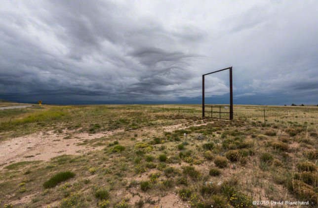 Gate and clouds in eastern New Mexico.