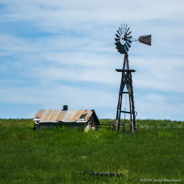 Windmill and Wyoming grasslands.