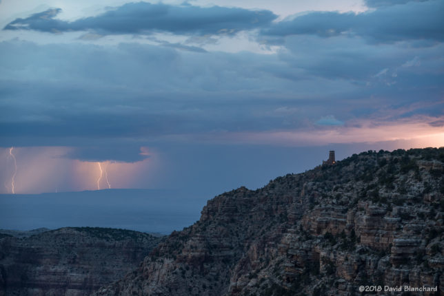 Lightning visibile from South Rim of Grand Canyon with Desert Tower in the distance.