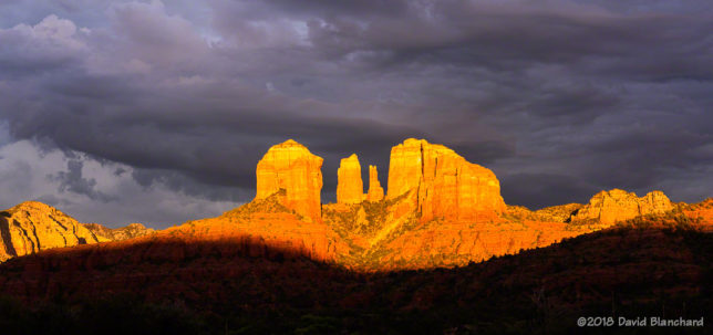Late afternoon sun briefly lights up Cathedral Rock in Sedona.