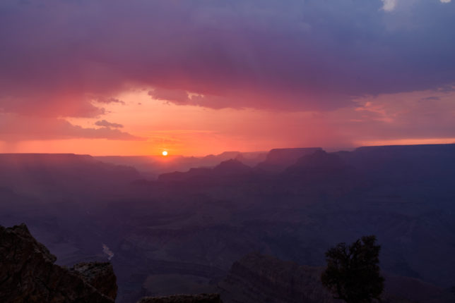 Smoke from the Obi Fire on the North Rim creates a colorful sunset.