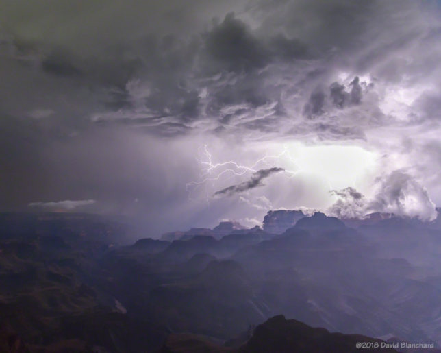 Lightning illuminates Grand Canyon at night.