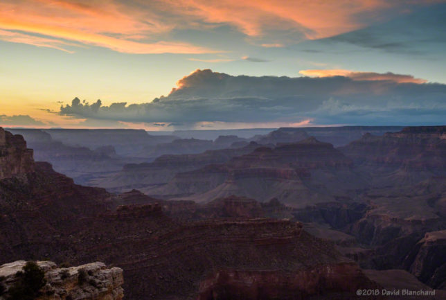 A backlit thunderstorm at sunset over Grand Canyon.