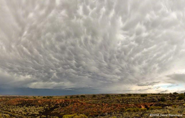 Cumulonimbus mammatus behind the storm.