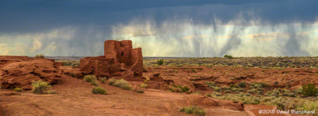 Lightning behind Wukoki Pueble in Wupatki National Monument.