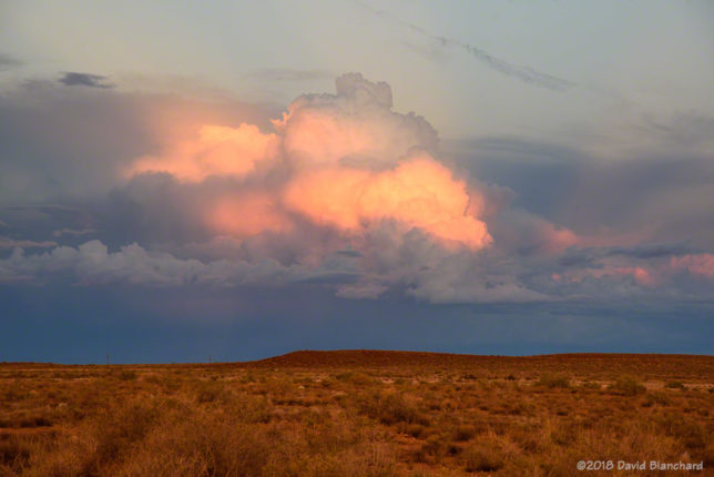 Cumulus convection takes on pastel colors as the sun sets. (1742 MST 21 October 2018)