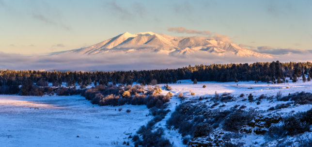 Clouds and fog clear away shortly after sunrise to reveal the San Francisco Peaks.
