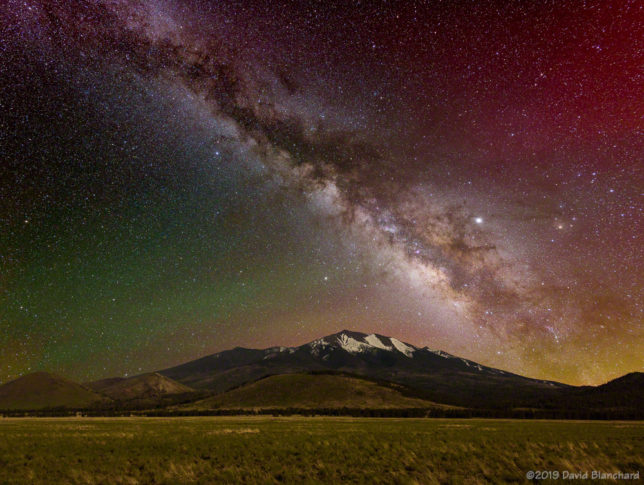 The Milky Way rises above the San Francisco Peaks in northern Arizona.