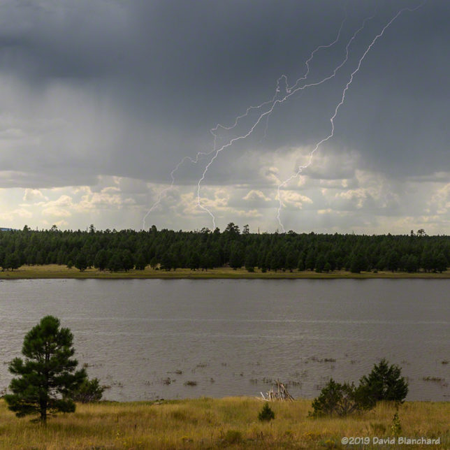 Lightning strikes in the distance behind Upper Lake Mary.