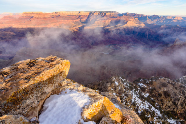 Clouds lift out of Grand Canyon.