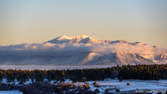 Fog and clouds wrap around the San Francisco Peaks.