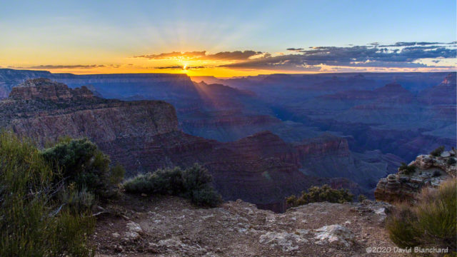 Sunset with crepuscular rays over Grand Canyon.